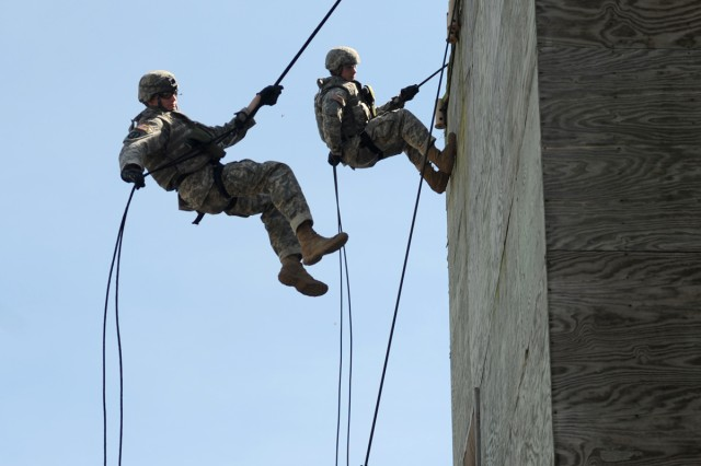 From the top of a 35-foot tower, Soldiers rappel immediately following firing weapons during Event 8, Reflexive Fire, during the 2011 Warfighter Competition at Fort Leonard Wood, Mo., Sept. 18-21, 2011.
