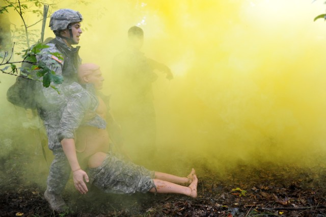 Spc. Ernest Trujillo drags a dummy casualty to safety during Event 4, Warrior Task/Battle Drills, during the 2011 Warfighter Competition at Fort Leonard Wood, Mo., Sept. 18-21, 2011.  Trujillo is a member of Team 29, from Joint Base Elmendorf, Alaska.