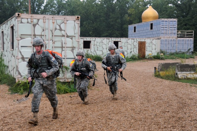 Team 15, from Columbus, Ohio, moves out after locating a suspected enemy combatant who was hiding in this training village during the 2011 Warfighter Competition at Fort Leonard Wood, Mo., Sept. 18-21, 2011.