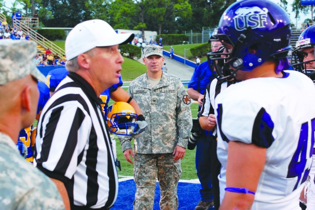 Fort Polk garrison commander Col. Roger Shuck participates in the pregame coin toss during the MSU football game Sept. 17.