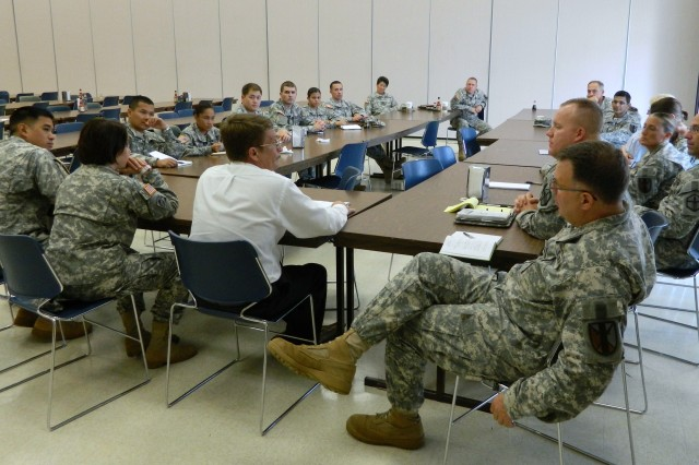FORT SHAFTER FLATS, Hawaii -- Soldiers of the 303rd Maneuver Enhancement Brigade participate in a round table discussion, here, Sept. 17, with Tommy Simmons, a capability manager from the Maneuver Support Center of Excellence, Training and Doctrine Command.