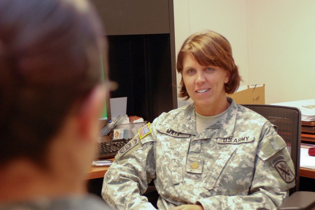 Maj. Terry Matz, behavioral science officer with the 95th Civil Affairs Brigade (Airborne), talks with a soldier in her office Sept. 20, 2011, at Fort Bragg, N.C.  Matz, who is the first social worker ever to be assigned to the relatively-new special operations brigade, brings with her the High Risk Management Team concept, a team-oriented approach toward preventing high-risk behaviors such as suicide.  (U.S. Army photo by Sgt. Jonathan A. Shaw)