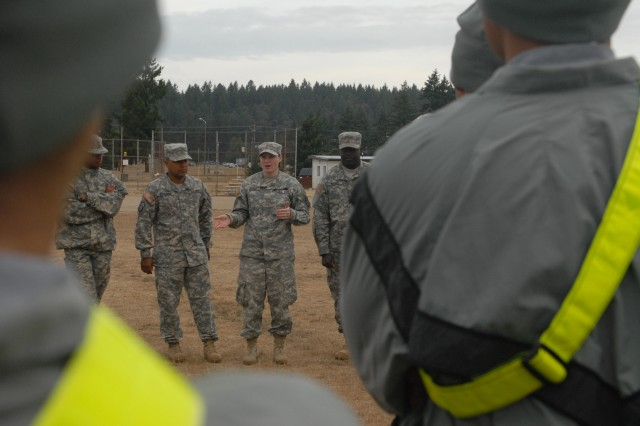Soldiers assigned to the 80th Ordnance Battalion, 593rd Sustainment Brigade listen as 2nd Lt. Rebecca S. Deal, the 80th Ord. Bn. Training officer, soon to be a platoon leader for the 63rd Ordnance Company, and native of Havelock, N.C., explains the challenges teams faced, and solutions they came up with, at her station of the battalion's Junior Leader Development Day, Sept. 16, 2011, on Joinst Base Lerwis-McChord, Wash. (Photo by Sgt. Kendra McCurdy)
