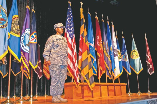 Master Sgt. Sheila Sango stands at attention after posting the colors of the U.S. Army Test and Evaluation Command during the BRAC Completion Ceremony at the post theater Sept. 15.