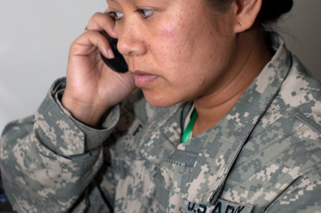 Capt. Marial Potts, S3 for the 48th IBCT of the Georgia Army National Guard, follows up by phone on a contracting issue during Natural Fire 11 in Zanzibar, Tanzania.
