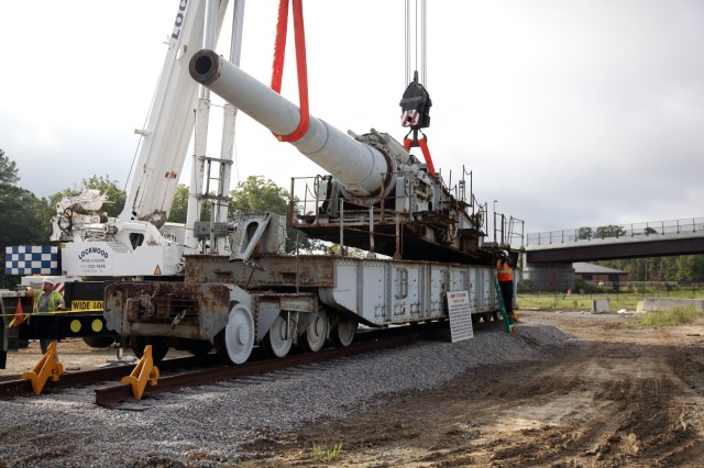 "Workers finish fitting the main gun on its railcar Sept. 27. The Ordnance School received its newest piece of heavy metal in the form of a historic U.S. Army 12"" railroad gun."