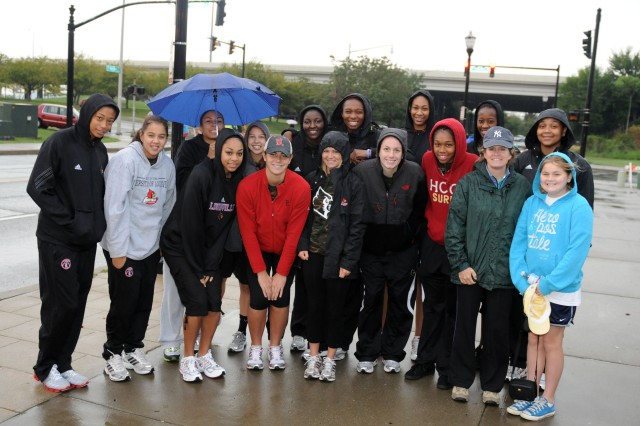 Col. Kristin K. French (2nd from right), commander of the 3d Sustainment Command (Expeditionary), poses with members of the University of Louisville's women's basketball team before the American Heart Association Heart Walk in Louisville on Sept. 24.  The Heart Walk is sponsored yearly to fund research, education and advocacy efforts of the American Heart Association. (U.S. Army photo by Sgt. Michael Behlin)