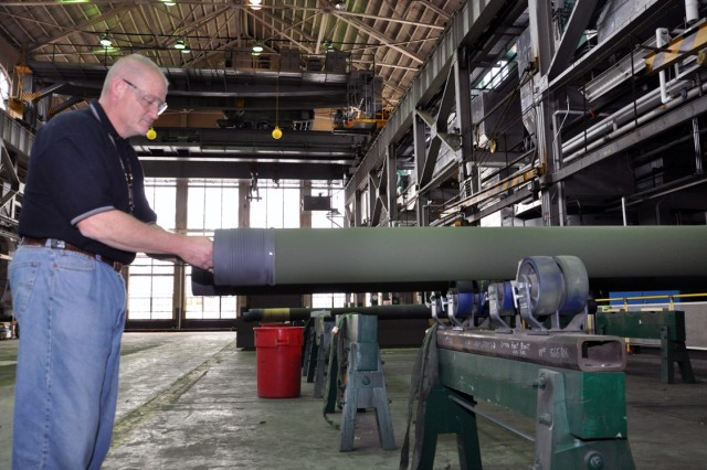 Tim Allard, the Arsenal's chief of the manufacturing support division, inspects an M776 barrel being readied for a 155mm lightweight howitzer, the M777.  This barrel is not for the new $12.5m order, but part of an existing order for the Army.