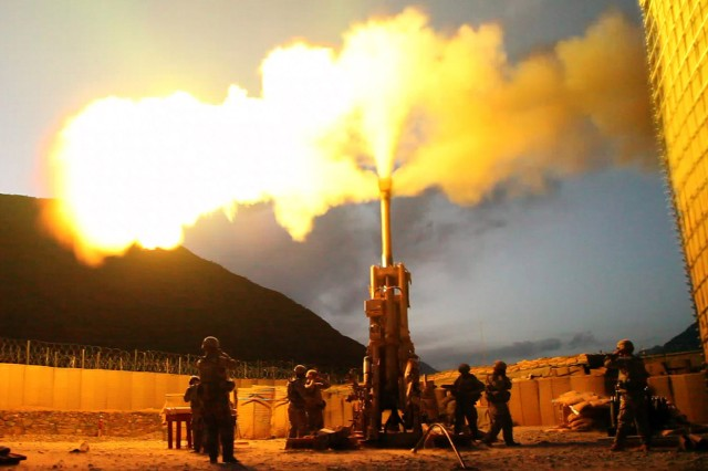 KONAR PROVINCE, Afghanistan -- Soldiers with Battery C, 1st Battalion, 321st Airborne Field Artillery Regiment, 18th Fires Brigade, 82nd Airborne Division from Fort Bragg, N.C., fire 155mm rounds using an M777 Howitzer weapons system, July 6, on Forward Operating Base Bostick, Afghanistan. The Soldiers were registering targets so they will have a more accurate and faster response time when providing fire support.