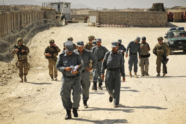 Afghan police lead the way during a joint patrol with the Laghman Provincial Reconstruction Team in the Mehtar Lam district in Afghanistan's Laghman province, Sept. 26, 2011.