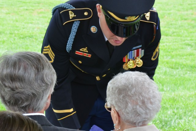 During an funeral ceremony, Sept. 22 at Arlington National Cemetery, a Soldier passes the burial flag of World War II Army Sgt. George H. Geffken to his widow, Mary Geffken. George served as an infantryman in the Pacific during the war.  His wife served in uniform during as a member of the Women's Army Auxiliary Corps.