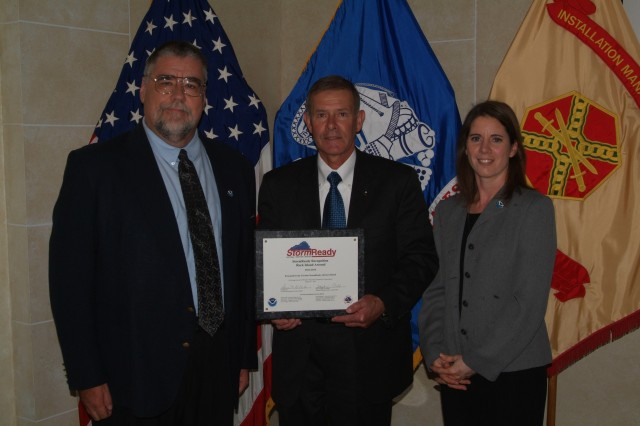 Joel Himsl, Garrison Manager, Rock Island Arsenal, accepts the NOAA's StormReady Recognition on behalf of the installation from Stephan Kuhl, Meteorologist in Charge, Quad Cities' National Weather Service and Donna Dubberke, Warning Coordination Meteorologist, Quad Cities' National Weather Service.