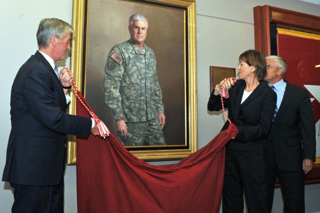 Secretary of the Army John M. McHugh, Sheila Casey and former Army Chief of Staff retired Gen. George W. Casey Jr., unveil Casey's official portrait at the Pentagon, Sept. 27, 2011.