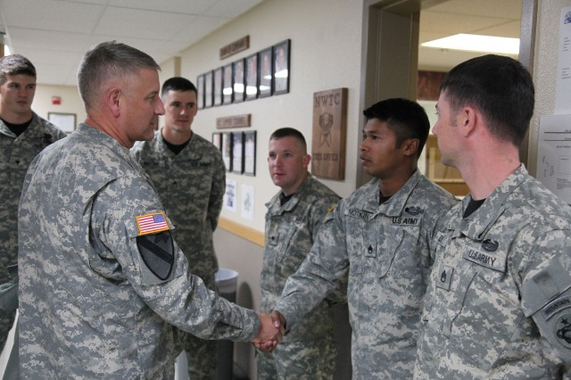 Sgt. Maj. of the Army Raymond F. Chandler III speaks with Basic Mountaineering Course Instructor Staff Sgt. Peter Notkin during a Sept. 22, 2011, visit to the Northern Warfare Training Center at Black Rapids, Alaska.