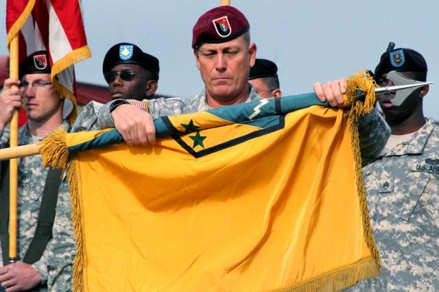 Command Sgt. Maj. James Dickens of the 2nd Engineer Brigade, furls the 3rd Maneuver Enhancement Brigade's colors, signaling the 3rd MEB's inactivation and the 2nd Engineer Brigade's activation Sept. 21 at Joint Base Elmendorf-Richardson Alaska.
