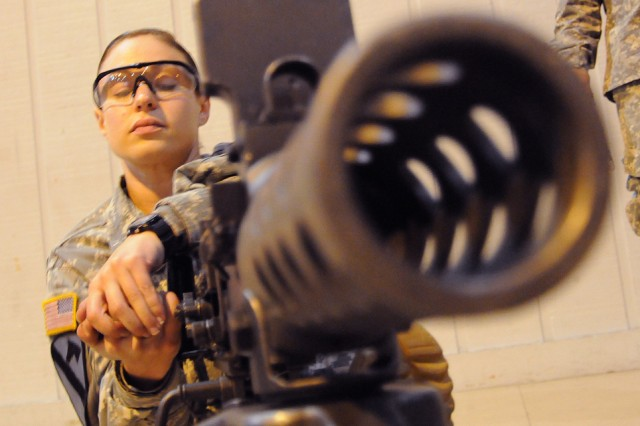 Staff Sgt. Alicia Anderson, representing U.S. Army Europe, works to disassemble an M2 .50 caliber machine gun during last year's Best Warrior competition.  Anderson and 23 others from commands throughout the Army competed in the five-day competition.