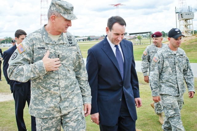 Duke coach Mike Krzyzewski chats with Maj. Gen. Robert Brown, his former player at Army, during a visit to Fort Benning Thursday.