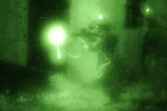 Soldiers from 2nd Battalion, 151st Infantry Regiment, Indiana Army National Guard, perform a night assault at Camp Atterbury Joint Maneuver Training Center Sept. 21. Bold Quest 2011 is a joint staff led combat coalition exercise to test the interoperability of target identification systems of member nations to reduce friendly fire incidents.