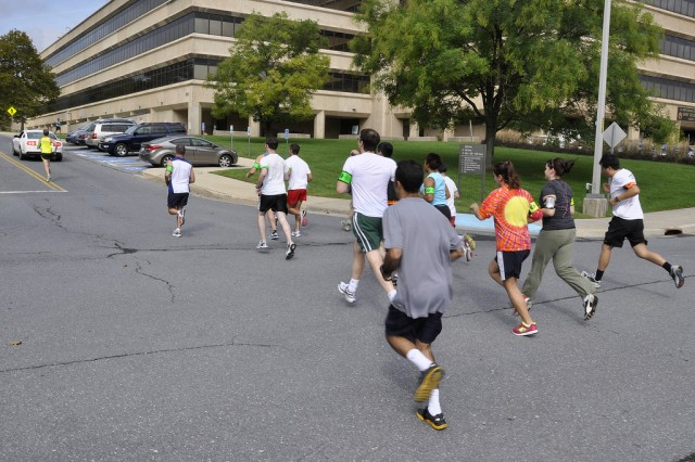 Runners start off in the the 5K run, running by the Harry Diamond Building during the 2011 Health, Wellness and Resiliency Expo at the Adelphi Lab Center.