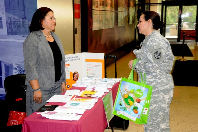 The American Cancer Society booth shares information with ALC workers during the 2011 Health, Wellness and Resiliency Expo at the Adelphi Lab Center.