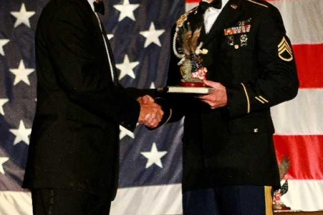 Staff Sgt. Andrew B. Brown is congratulated by Mr. Forey Hamilton, the Patriot Awards committee chairman.