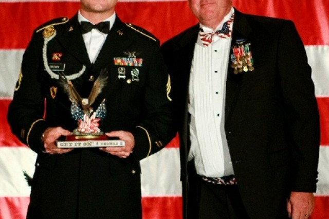Staff Sgt. Andrew B. Brown poses with Mr. T.I. Weintraub, the president of the Rocky Mountain Chapter of NDIA.