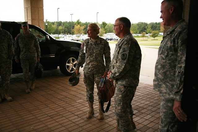 Lt. Gen. Richard P. Formica, commanding general, U.S. Army Space and Missile Command/Army Forces Strategic Command, greets Gen. Ann E. Dunwoody, commanding general, U.S. Army Materiel Command, at USASMDC/ARSTRAT's headquarters on Redstone Arsenal, Ala., Sept. 27. With AMC's  recent relocation to Redstone Arsenal as part of the 2005 Base Realignment and Closure, Dunwoody visited the command to learn about its mission and receive a tour.