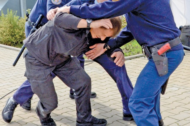 Pond guards apprehend a suspicious person during training at the Pond training facility in Freigericht-Bernbach, Germany.