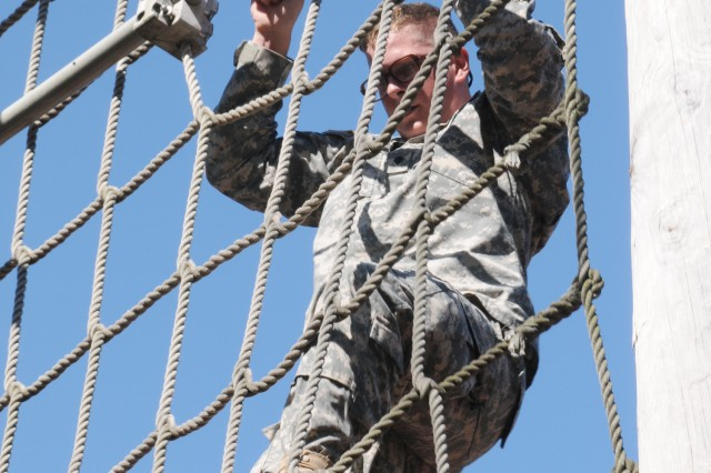 "Spc. Reese Freeman, 4th Battalion, 31st Infantry Regiment, climbs down a rope net on ""zero day"" Aug. 12."