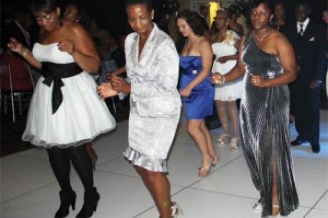 Lindsay Kidd, Josie Emery, Dedra Carter, Staff Sgt. Harold Young, Sgt. 1st Class Atiya McNair and others dance the night away at Second-Chance Prom.