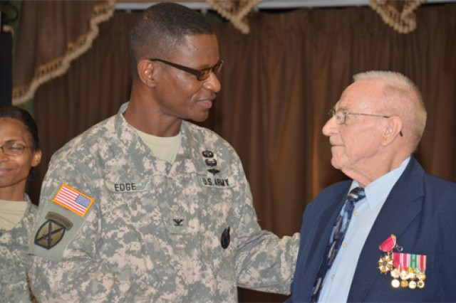 Col. Rodney Edge, U.S. Army Garrison, Fort Lee commander speaks about the actions of retired Lt. Col. Neal C. Brayton in 1968-69 that led to the psyh-ops officer earning the Legion of Merit Award.