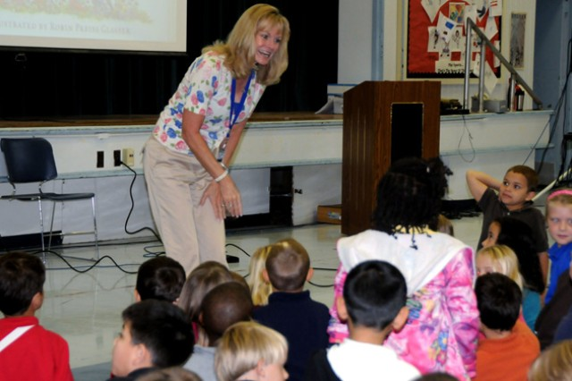 Kimberly Crutchfield, wife of Maj. Gen. Anthony G. Crutchfield, interacts with Fort Rucker Elementary school students after reading a book on American history.