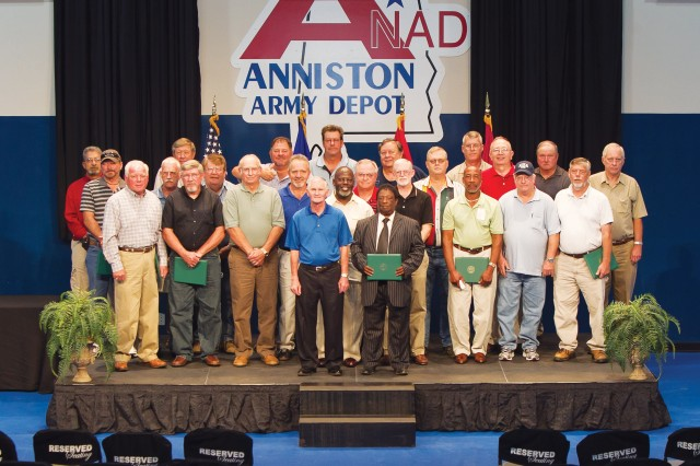 Anniston Army Depot retirees who were recognized at the Sept. 22 Consolidated Retirement Ceremony pose for a photograph: Lynn L. Amos, Richard E. Bell, Michael W. Brown, Rodney F. Cate, Jerome Chapman, Robert R. Coleman, John G. Daniel, Michael P. Deering, Charles R. Dulaney, William C. Evans Jr., Terry S. Faulkner, Gary W. Ford, James R. Gilley, James C. Hardy, Larry K. Heath, Billy W. Jones, Van R. Loggins, John W. Madison, William A. Magouyrk, Terry L. McNeal, Roger D. Pennington, Luther V., Jr. Ridgnal, Shannon C. Steward, James L. Thomason and William L. Totherow. These employees represent a combined 774 years of federal service.