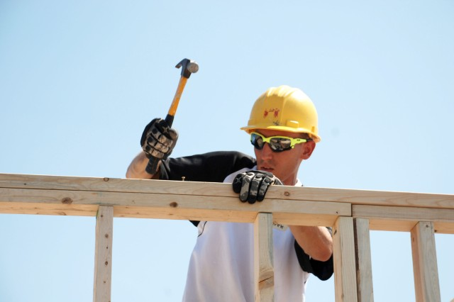 Sgt. Derek Jones drives in a nail to reinforce a wall frame. He and nine other Soldiers from the 470th Military Intelligence Brigade helped to build houses in southwest San Antonio Sept. 23 in support of Habitat for Humanity. (U.S. Army photo by Gregory Ripps)