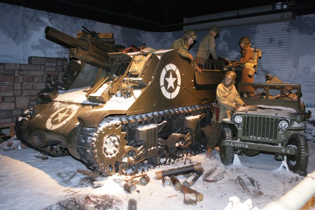 A restored M7 Priest at the Fort Sill Field Artillery Museum depicts self-propelled artillery support during the Battle of the Bulge. The Army produced about 4,200 Priests which served extensively through World War II and into the Korean War.