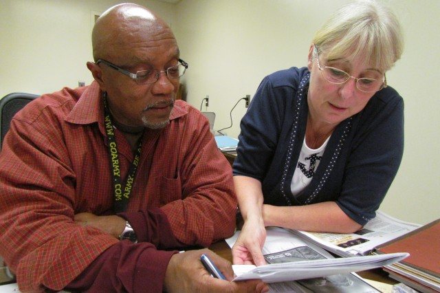 Ed Adams, the Garrison's new retirement services officer, looks over plans for Retiree Appreciation Day with Barbara Moudy, chief of Transition Point, which assists service members in moving from military to civilian life. Retiree Appreciation Day will be Friday and Saturday.