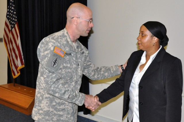 Lt. Col. Frank Sobchak, U.S. Army Garrison-Natick commander, speaks with Andrea McKie, substance abuse specialist at Hanscom Air Force Base, after she spoke Sept. 28 at Natick's Suicide Prevention Awareness Program and Training.