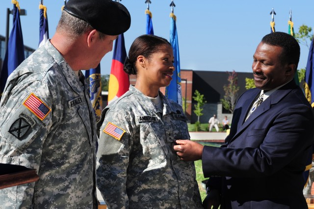 Maj. Gen. Marcia M. Anderson receives her second star from husband Amos during a Sept. 29 ceremony at Fort Knox, Ky. The U.S. Army Accessions Command and Fort Knox commanding general, Lt. Gen. Benjamin Freakley (at left), watches the pinning of the two-star rank. Anderson, deputy commanding general of the U.S. Army Human Resources Command, is the first-ever female U.S. Army African-American officer to obtain the rank of major general. (Photo Credit: Sally Harding, Ft Knox VI)