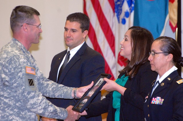 """Garrison Commander Col. Wayne Green thanks Hispanic Heritage Month speakers Luis Alvarez III, Federal Bureau of Investigation special agent and former member of the Marine Security Company for the U.S. president; Iris Hermosillo, """"Que Pasa, KC?"""" co-host and part of KCTV's Storm Track 5 Weather team; and Maj. Leticia Walpole, School of Advanced Military Studies student who escaped poverty in Mexico City to tell """"A Dream Come True,"""" after their presentations at the observance luncheon Sept. 22 at the Frontier Conference Center, Fort Leavenworth, Kan."""