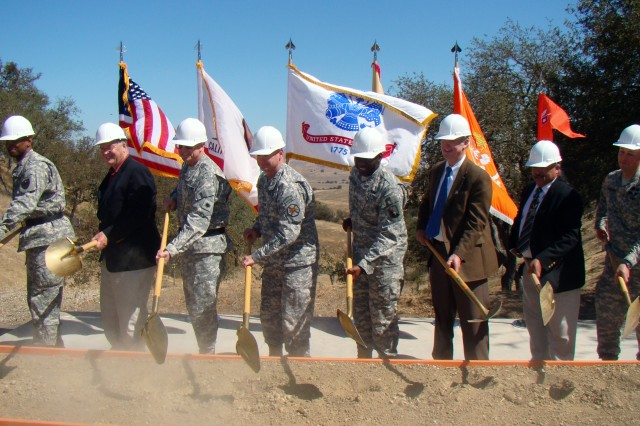 CAMP ROBERTS, Calif. - Participating in the ground-breaking ceremony were (from left) Brig. Gen. LaWarren Patterson, 7th Signal Command commander; U.S. Rep. Sam Farr; Brig. Gen. Keith Jones, 40th Infantry Division assistant division commander for Support and senior commander of Camp Roberts; Col. Joel Clark, Presidio of Monterey garrison commander; Col. Aaron Webster, 21st Signal Brigade commander; Les Turnbeaugh, U.S. Army Corps of Engineers project manager; Freddy Romero, cultural preservation consultant; and Maj. Kevin Garfield, 514th Signal Company commander.