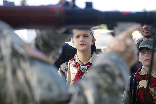 Brennan Schulte, a Boy Scout in Troop 451, Shawnee, Kan., center, looks at an RPG being shown at the EOD display during Fall Apple Day Festival  Sept. 24 at Artillery Parade Field, Fort Riley, Kan.