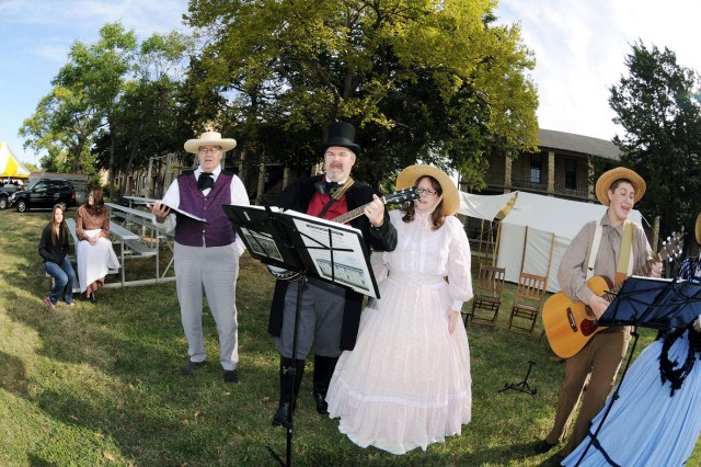 The Territorial Trubadors, a singing group associated with the First Territorial Capital of Kansas, located at Fort Riley, perform during Fall Apple Day Festival Sept. 24 at Artillery Parade Field on Main Post, Fort Riley, Kan. The group was one of many re-enactors who were part of the historic section of the festival.