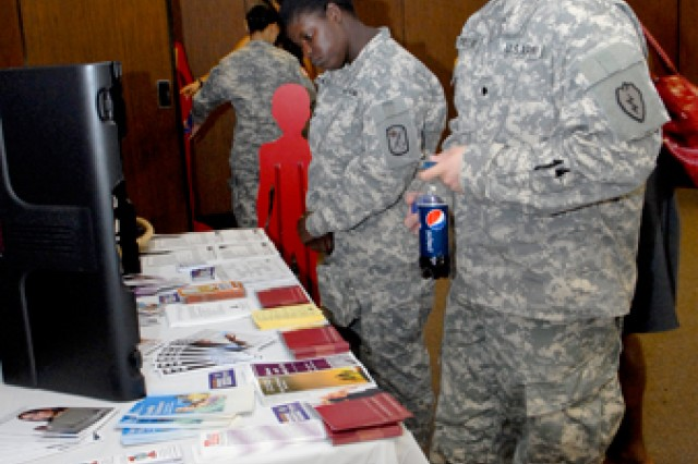 Soldiers look at a domestic violence prevention display set up at the post conference room, Schofield Barracks, Monday. USAG-HI's annual proclamation against domestic violence was signed at the event.