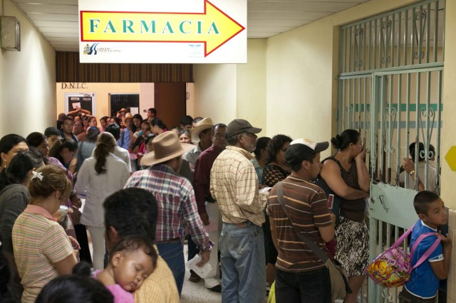Customers of Hospital Escuela in Tegucigalpa, Honduras, wait in line to enter the pharmacy. This line, photographed at 8 a.m., grows throughout the day, as do many of the crowded areas of the hospital.