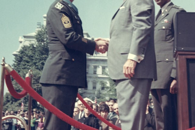 "FORT CARSON, Colo. -- 1st Sgt. David H. McNerney, left, shakes President Lyndon B. Johnson's hand after receiving the Medal of Honor in a ceremony at the White House Sept. 19, 1968. McNerney was the last living ""Ivy"" Division Soldier to receive the nation's highest honor. He died Oct. 10."