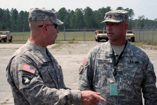 Colonel Christopher Hughes 3rd Inf. Div. Deputy Commanding General-Support, discusses the recent Mission Rehearsal Exercise with Maj. Paul Frederick, MCTP Operations Group Alpha. Third Infantry Division is being prepared for a possible deployment in support of Operation New Dawn.
