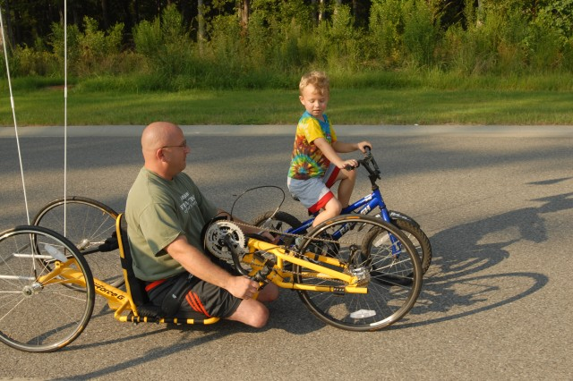 Still driven to ride a bike with his sons, Jason Letterman uses his hands on the Top End Force G, a specialty bike costing nearly $5K, to take an afternoon ride around the neighborhood with his son Alexander. Letterman is still able to do many Family activities with adjusted equipment.