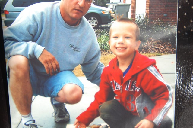 While living in Fort Stewart Housing in 2005 before a deployment and before his injury, Jason and his son Danil pose with their fish catch from around the area.