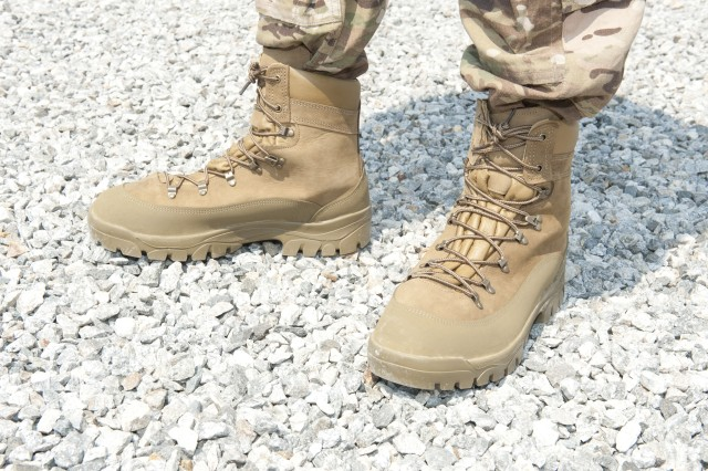 The Army Combat Boot is a tan-colored, temperate weather combat boot with a moisture-resistant, rough-side-out cattlehide leather and nylon duck upper. It contains a waterproof breathable membrane and integrated safety features such as limited fire-, conductive heat- and liquid fuel penetration-protection.