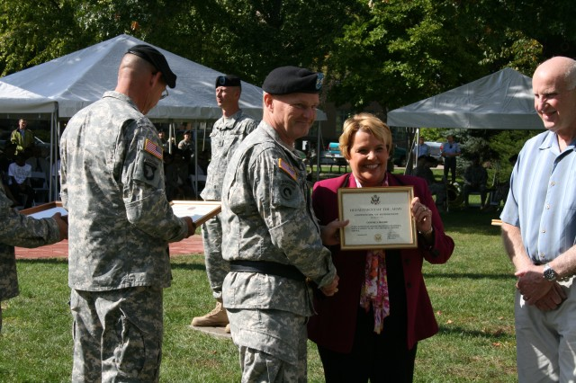 Maj. Gen. Yves J. Fontaine, ASC commanding general, presents Connie Moore, ASC retiree, with a certificate of retirement at the retirement and retreat ceremony, Sept 29. (Photo by Megan McIntyre, ASC Public Affairs)